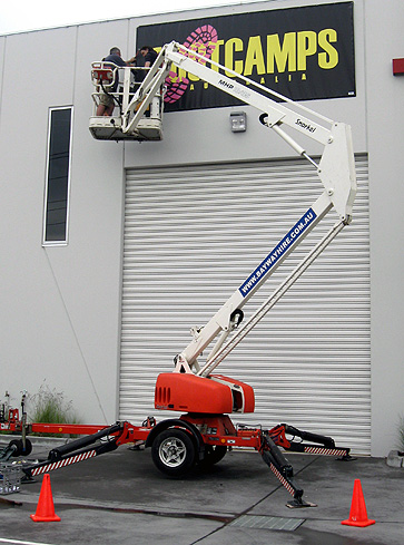 INSTALLING BANNER WITH BOOM LIFT